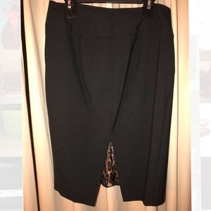 5/$25 Women's size 2 black with leopard skirt